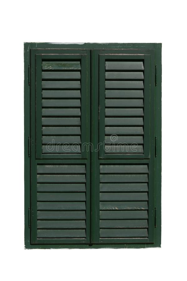 Closed wooden window with green shutters isolated on white surface. stock photo