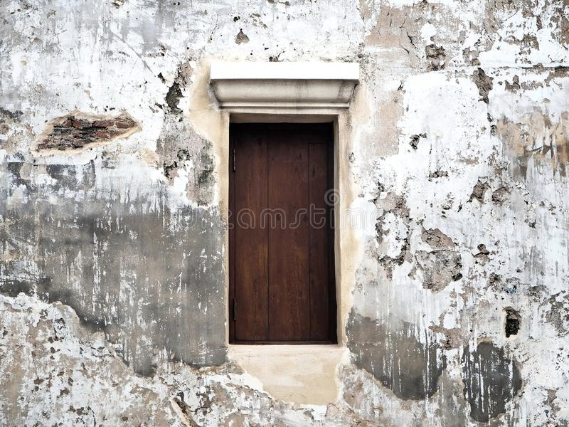 Closed Wooden Window on the Old White Concrete Wall stock images
