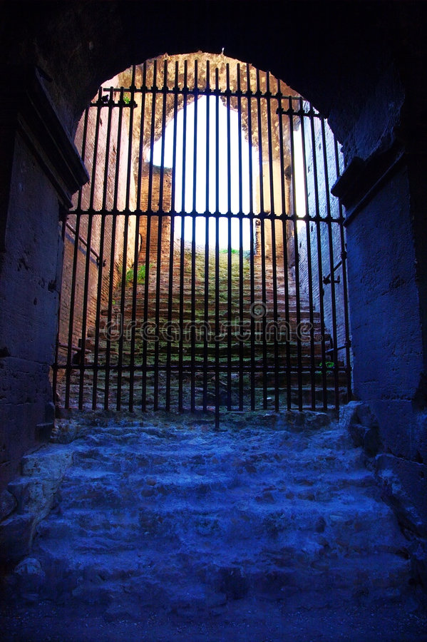 Closed wrought-iron gate in an underground stock images