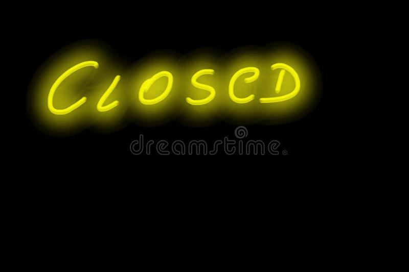 Closed yellow neon glowing text handwriting royalty free stock photos