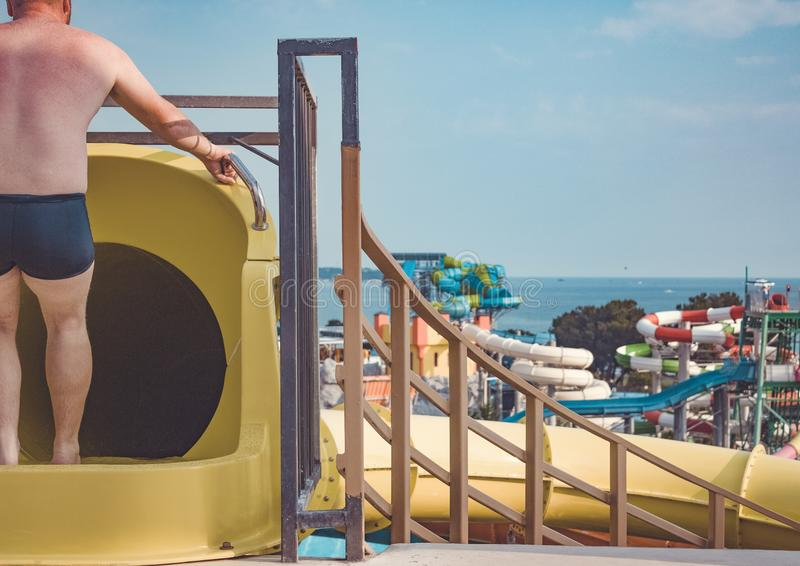 Closed yellow water slide on the background of the water park. royalty free stock photo