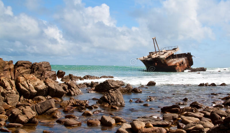 ClosedAghullas shipwreck lying on the rocks royalty free stock photography