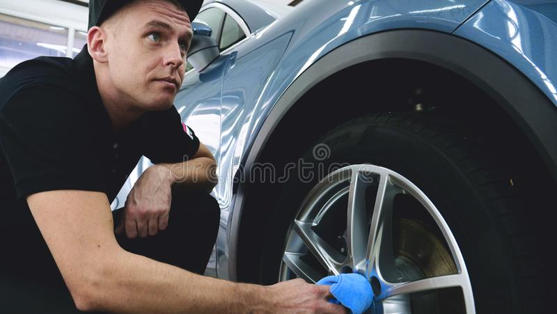 Closely shown as a professional worker polishes the transport car body using a polishing tool machine. Concept from: Auto serv. Ice, Car Painting, Machine stock images