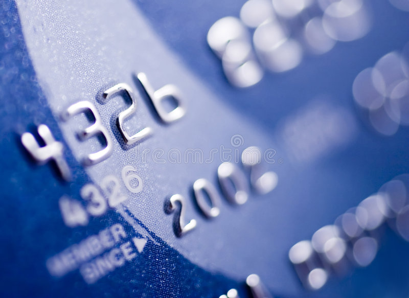 A closer look at credit. Close-up of silver digits on a credit card. Very shallow depth of field, focus on number 2. You can see the texture of the card in the royalty free stock photo
