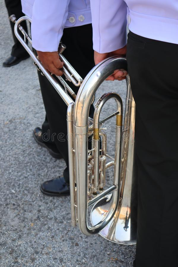 Closer to the hands of people holding musical instruments such as blower Most will be used in the marching band. Closer to the hands of people holding musical stock photo