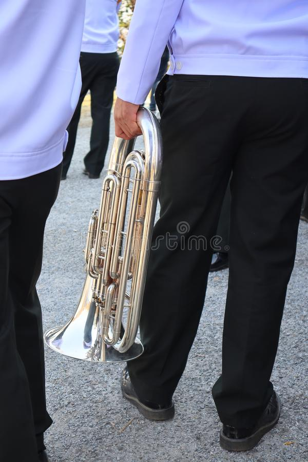 Closer to the hands of people holding musical instruments such as blower Most will be used in the marching band. Closer to the hands of people holding musical stock photos