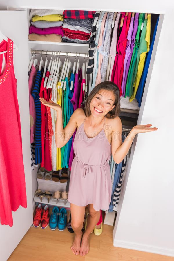Closet woman outfit confusion funny face expression royalty free stock photography