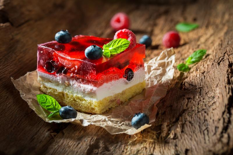 Closeu of cheesecake with fresh blueberries and raspberries stock image