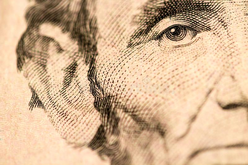 Closeup of Abraham Lincoln Face on Five Dollar Bill royalty free stock photography