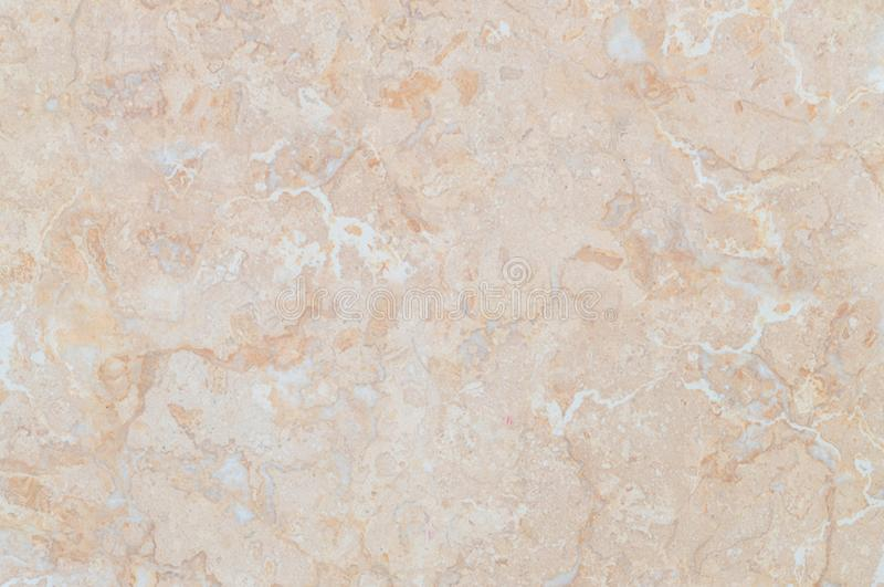 Closeup surface abstract marble pattern at brown marble stone wall texture background. Closeup abstract marble pattern at brown marble stone wall texture stock image