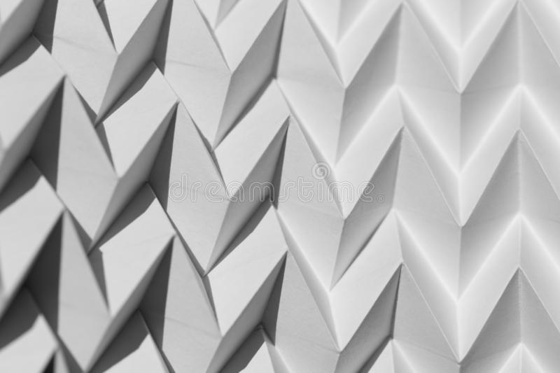 Closeup abstract white folded origami geometrical jigsaw paper pattern background royalty free stock photo