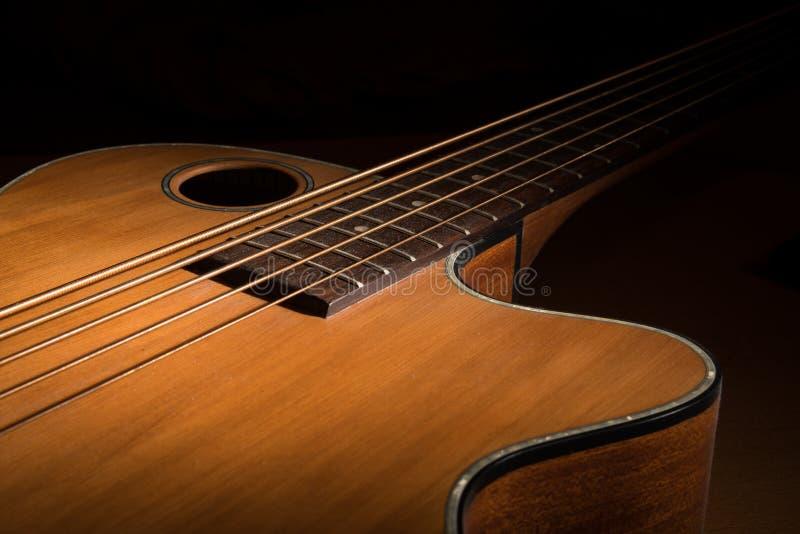 Closeup of an accoustic bass low key. Closeup of a brown accoustic bass low key stock photos