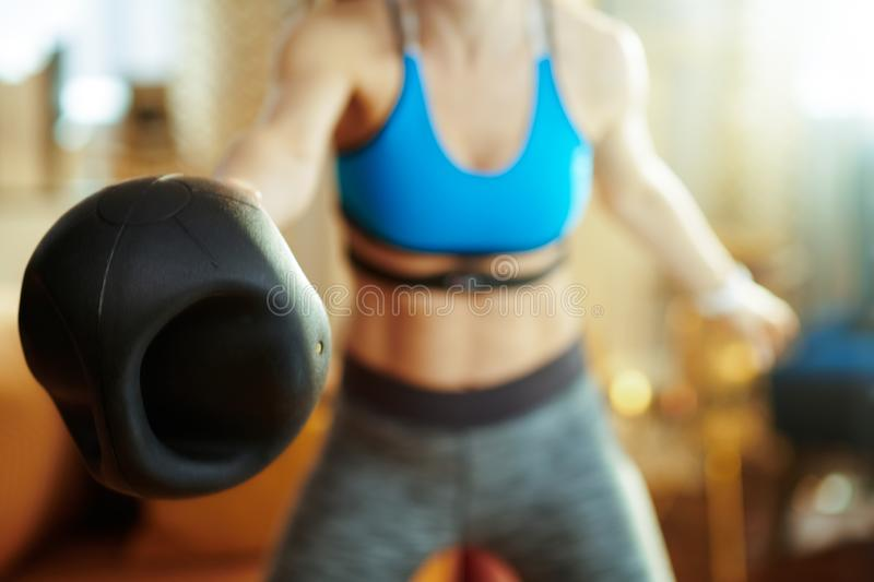 Closeup on active woman doing functional training exercise royalty free stock images