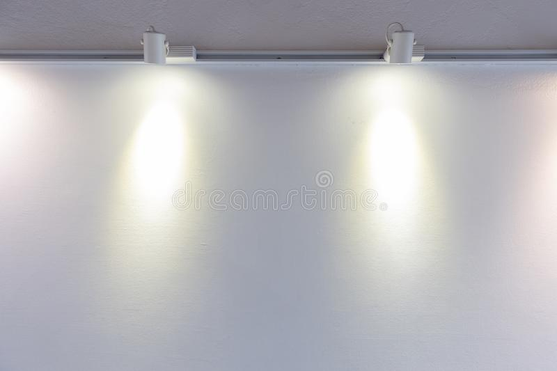 Closeup of adjustable downlight installed on white wall royalty free stock image