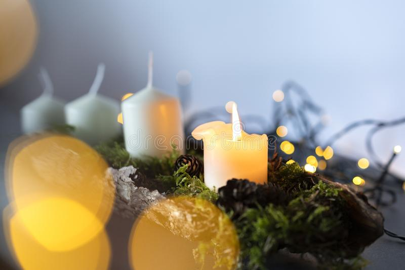 Advent christmas wreath with 4 candels and the first candel burning. Closeup of an advent christmas wreath line with 4 candels the first candel is burning stock photography