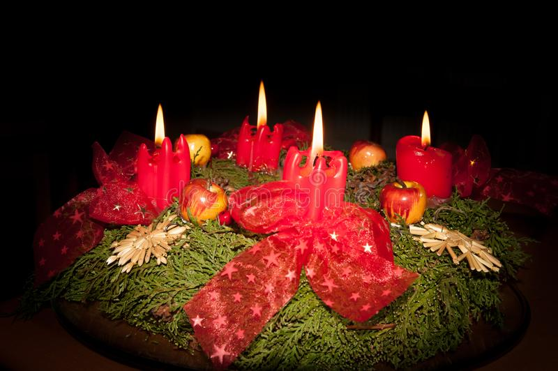 Closeup of an advent wreath with 4 burning candles royalty free stock photos