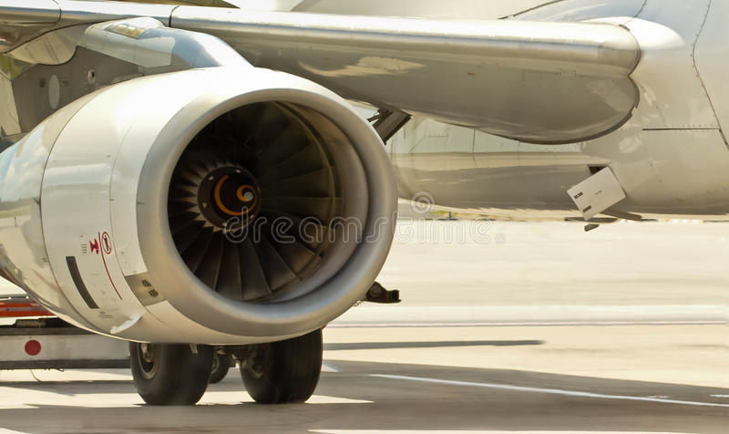 Closeup of airplane engine. Electronic testing on jet airplane engine as it is parked on the tarmac royalty free stock photography