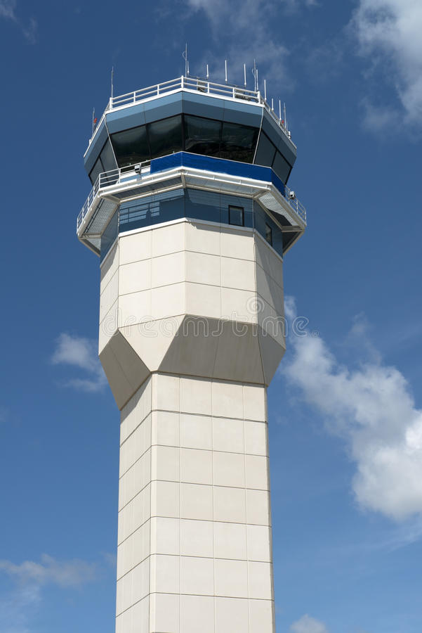 Closeup of Airport Air Traffic Control Tower. Closeup of an airport air traffic control tower. Blue sky and clouds are in the background royalty free stock photos