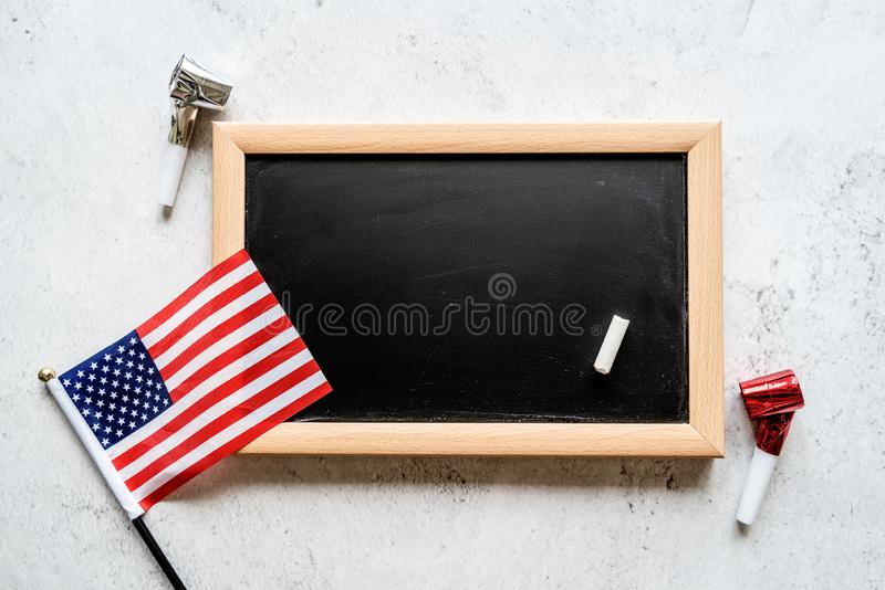 Closeup of American flag with a chalkboard with copy space for text royalty free stock photography