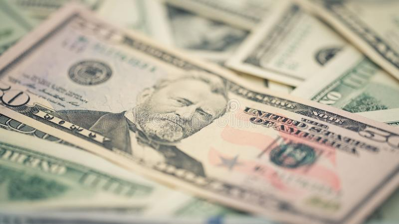 Closeup American money fifty dollar bill. Ulysses Grant portrait, us 50 dollar banknote fragment macro stock photography