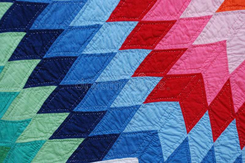 Closeup of Amish Quilt diamond pattern royalty free stock image
