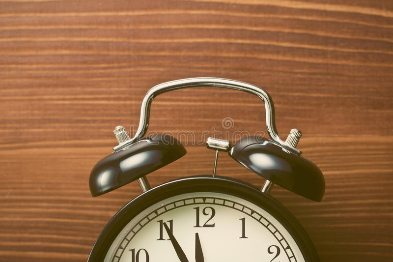 Closeup of analog retro alarm clock. The closeup of analog retro alarm clock royalty free stock photography