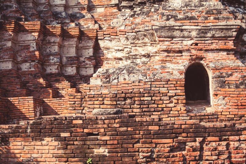 Ancient Ayutthaya Closeup. Closeup of ancient brick walls in Ayutthaya temple, Thailand. Perfect ancient geometry stock photo