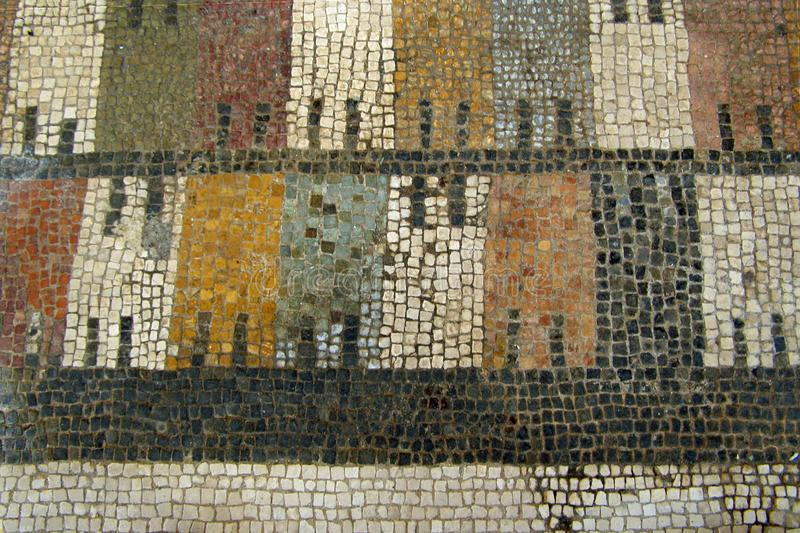 Closeup of an ancient floor mosaic with a colorful striped pattern in Pompeii, Italy, Europe. The ancient Roman city Pompeii near modern Naples is near modern royalty free stock photography