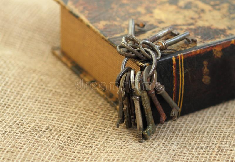Closeup of ancient keys on old folio. Secret studies concept. Historical studies concept royalty free stock photos