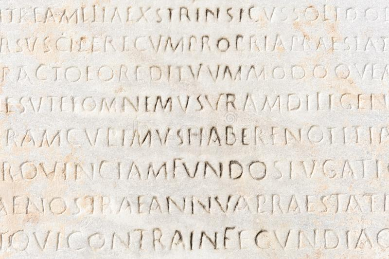 Closeup of ancient latin text royalty free stock photos
