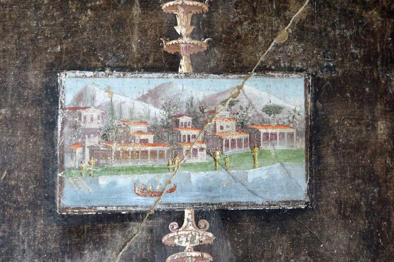 Closeup of an ancient tablinum showing boats and villas in front of Mt Vesuv; Casa di Marco Lucrezio Frontone, Pompeii, Italy. The ancient Roman city Pompeii stock photography