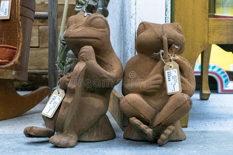 Closeup of antique frog statues in a vintage store in the United States in Mason. MASON, UNITED STATES - Jul 09, 2019: A closeup of antique frog statues in a royalty free stock images
