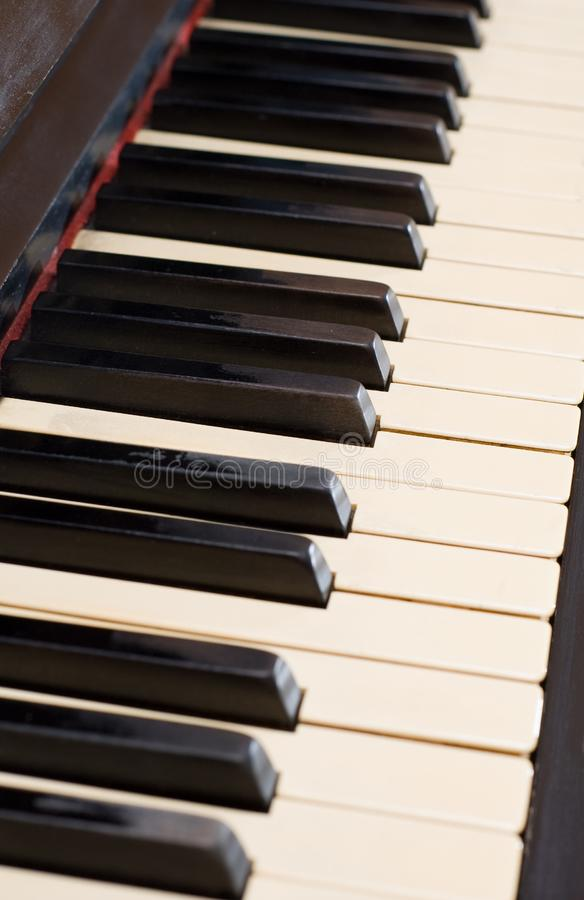 Closeup antique piano with yellowish old keyboard stock photo
