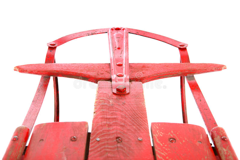 Closeup of an antique red sled. Close-up of an antique red sled on white royalty free stock photo