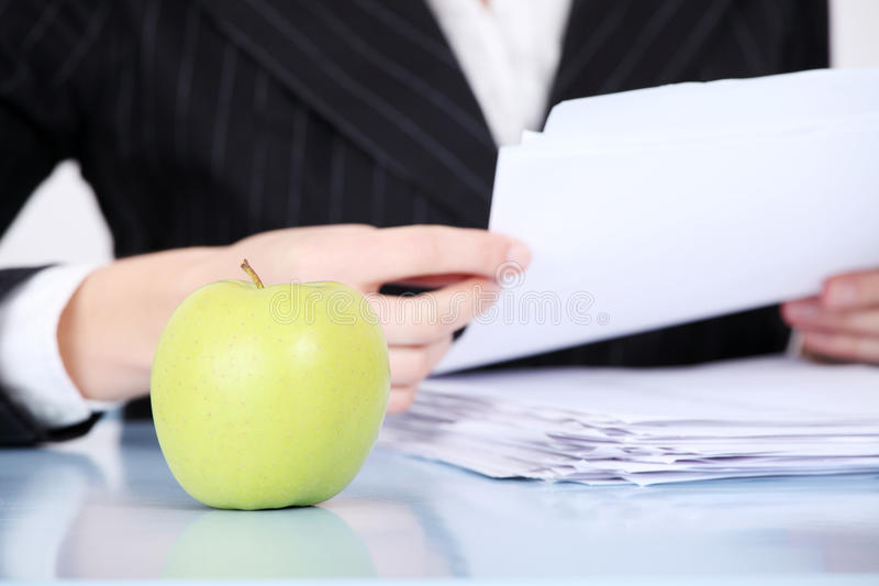 Closeup on apple in the office. stock image