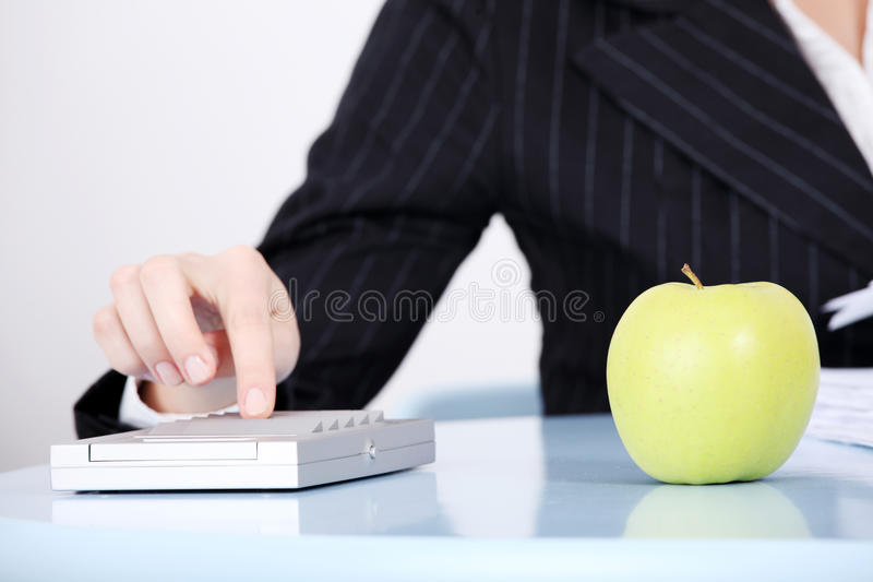 Download Closeup On Apple In The Office. Stock Photos - Image: 22051933