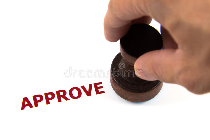 Closeup of approved on rubber stamp royalty free stock images