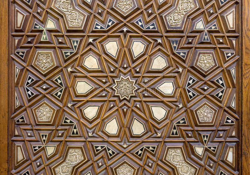 Closeup of arabesque ornaments of an old aged decorated wooden door, Cairo, Egypt. Closeup of arabesque ornaments of an old aged decorated wooden door, Old Cairo royalty free stock photo