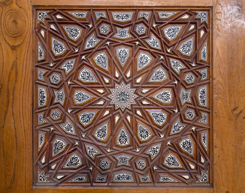 Closeup of arabesque ornaments of an old aged decorated wooden door, Cairo, Egypt. Closeup of arabesque ornaments of an old aged decorated wooden door, Old Cairo stock photo