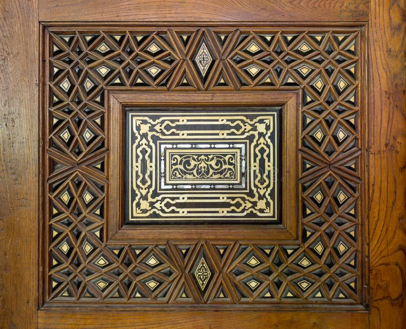 Closeup of arabesque ornaments of an old aged decorated wooden door, Cairo, Egypt. Closeup of arabesque ornaments of an old aged decorated wooden door, Old Cairo royalty free stock photos