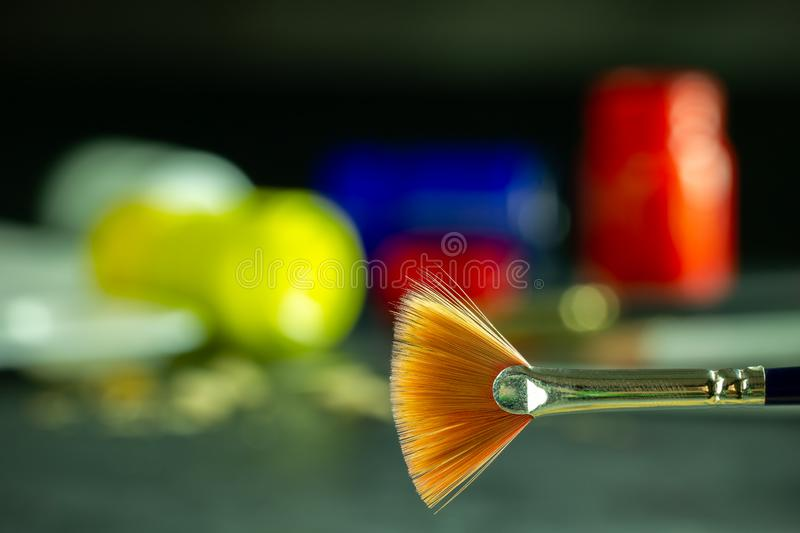 Closeup artist paint brush and poster color bottle blur background. Copy space for text. Concept of art education stock photos