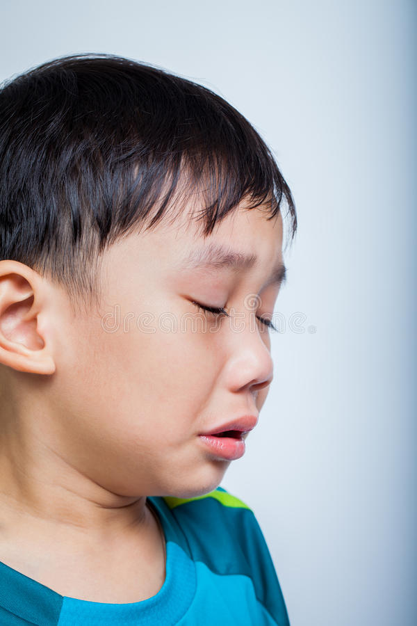Closeup asian boy (thai) crying royalty free stock photos