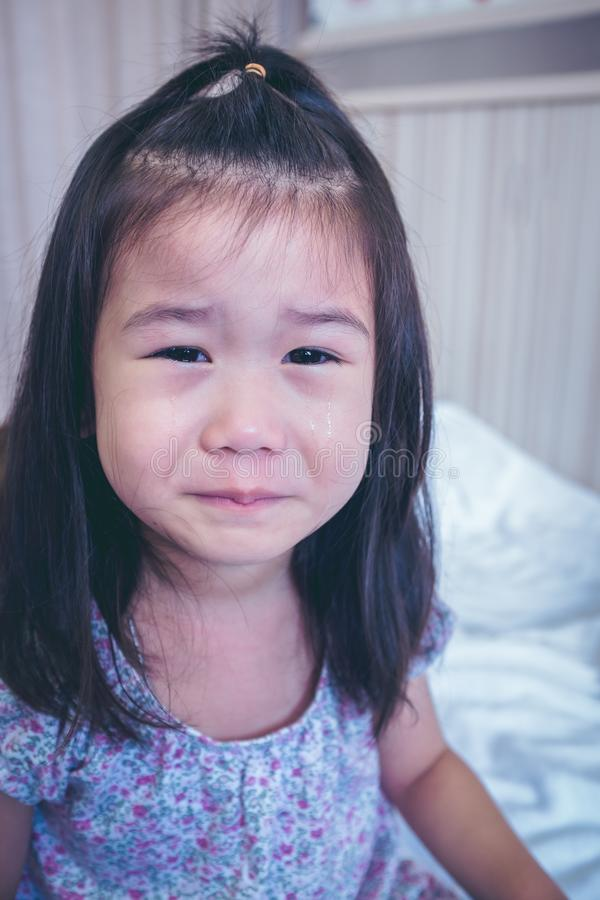 Closeup asian child crying with tears sadden, facial expression. royalty free stock image
