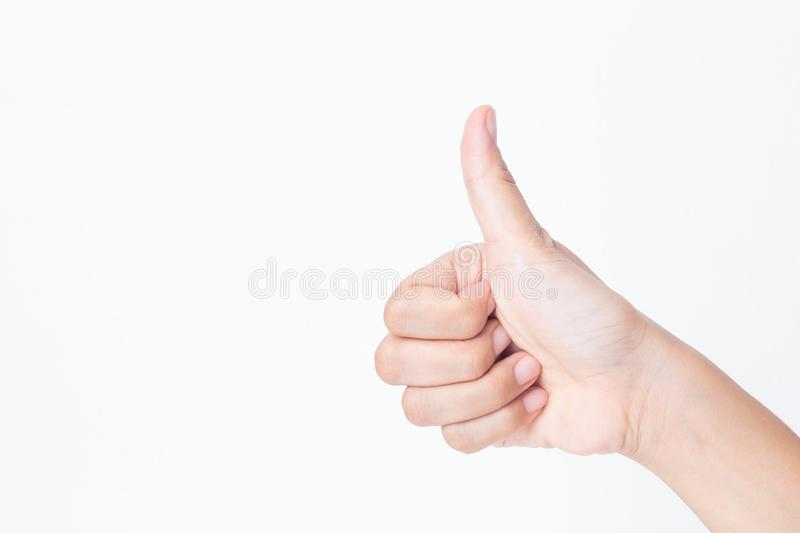 Closeup asian woman finger making thumbs up sign like white background stock image