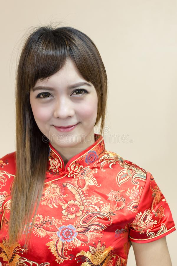 Closeup of asian woman greeting in traditional Chinese or cheongsam in chinese new year celebration stock image