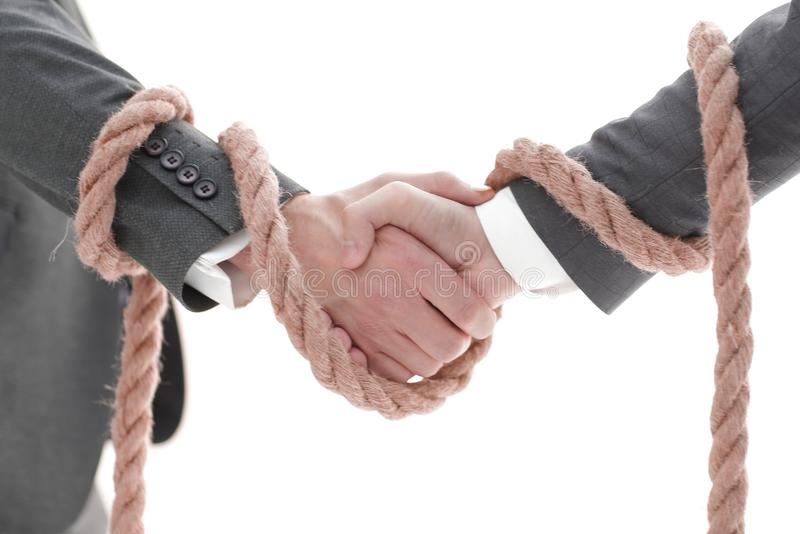 Closeup .the associated handshake business partners. royalty free stock photo