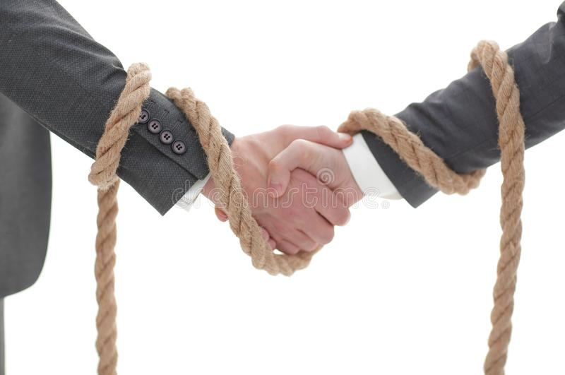 Closeup .the associated handshake business partners. royalty free stock image