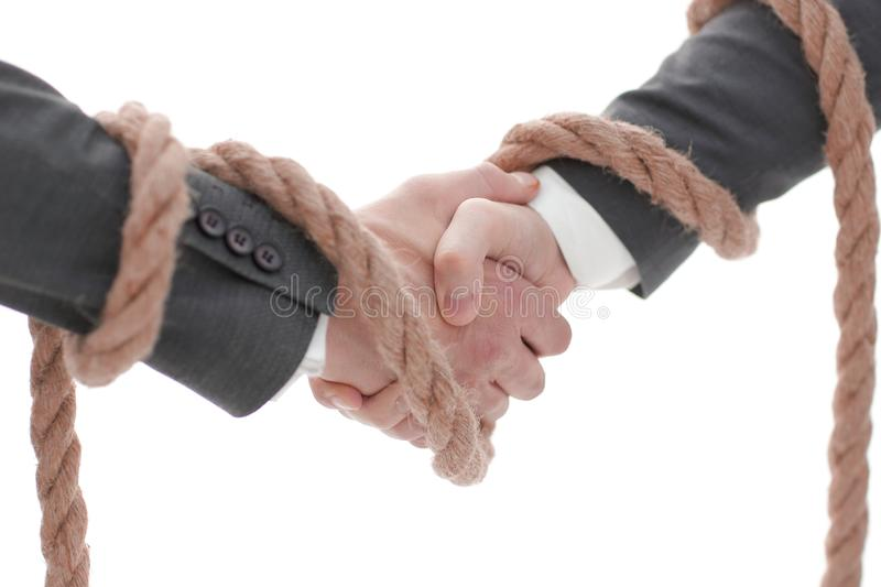 Closeup .the associated handshake business partners. royalty free stock photography