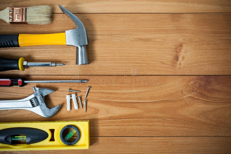 Closeup of assorted work tools on wood stock image