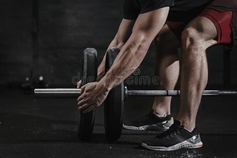 Closeup of athlete preparing for lifting weight at crossfit gym. Barbell magnesia protection. Practicing functional training p stock images